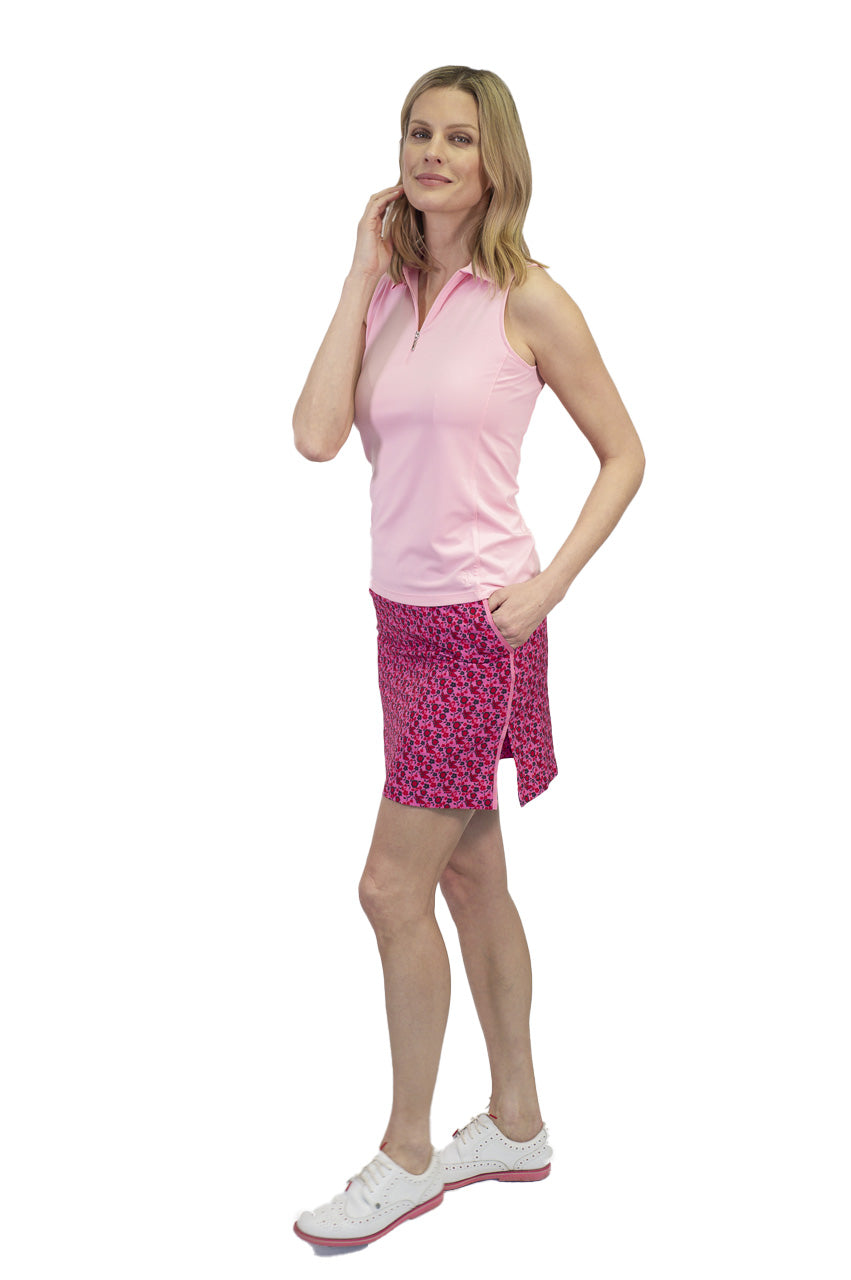 Women's hot pink light pink floral golf skort. Ladies performance designer golf skort by Golftini. Women's golfwear skirts and tops
