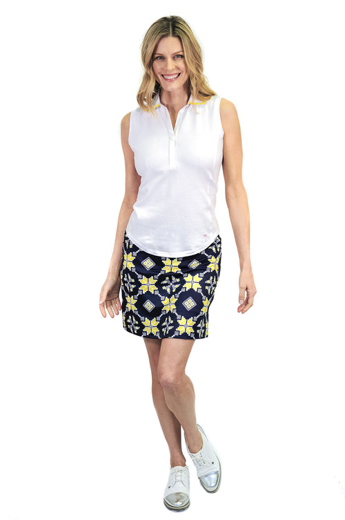 navy and yellow medallion pull on designer golf skort with a white sleeveless golf polo