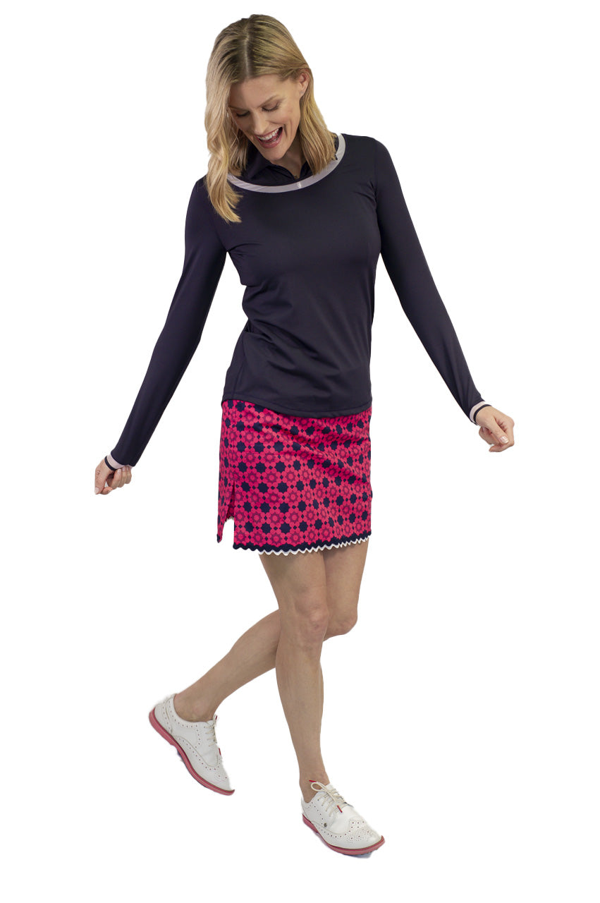 Women's hot pink and navy stretch designer golf skort with bottom trim. Women's navy long sleeve stretch top.