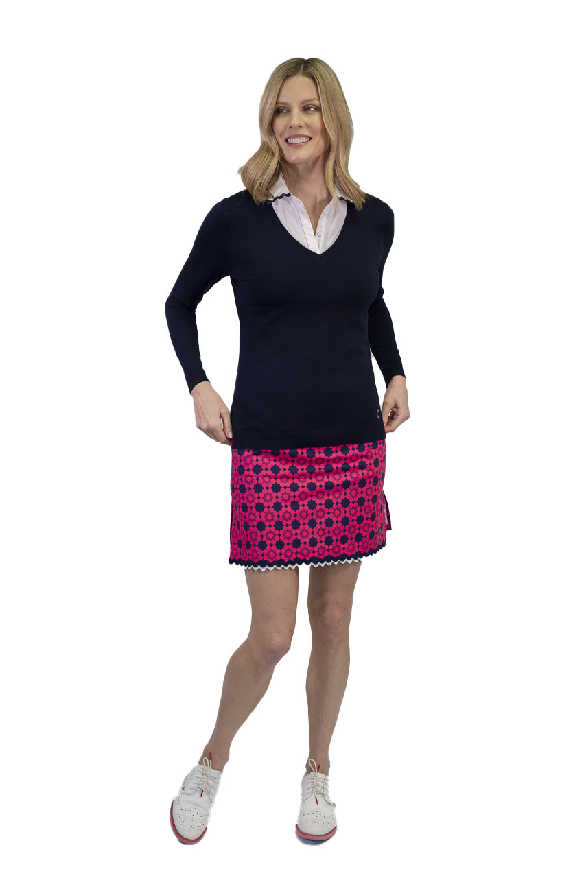 Women's hot pink and navy stretch designer golf skort with bottom trim. Navy long sleeve v-neck sweater