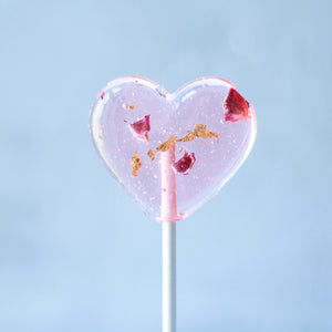 Heart lollipops with rose petals gold leaf bridal events gourmet candy