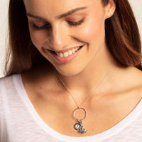 "Charm Pendant ""Disc Baby Footprint"""