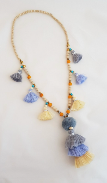 Long necklace in wood beads in rosaries design with Multi Tassels and Pompoms