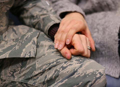 holding hands with PTSD victim