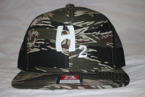 Hebert Camo and White Snapback