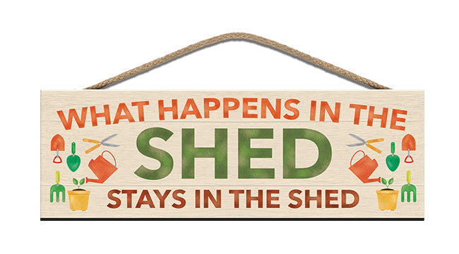 Wooden Sign - What happens in the shed