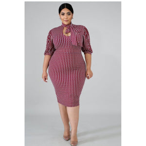 print body-con polka dot dress features, a stretchy fabric, mock tie neckline, puffy sleeves, and back zipper closure