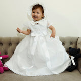 Beautiful Baby wearing our Christening Dress G005 in white with traditional hat