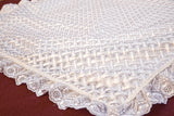Close up handmade Embroidered white baby blanket