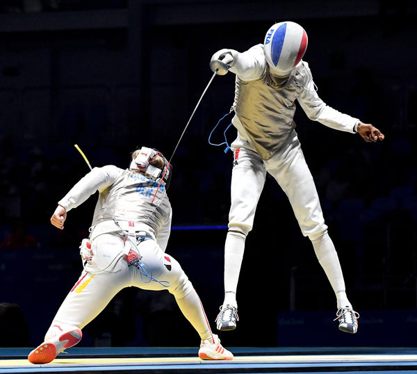 Fencing competitors using the Foilguard chest protection