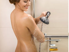 Woman showering using bubblerain showerhead