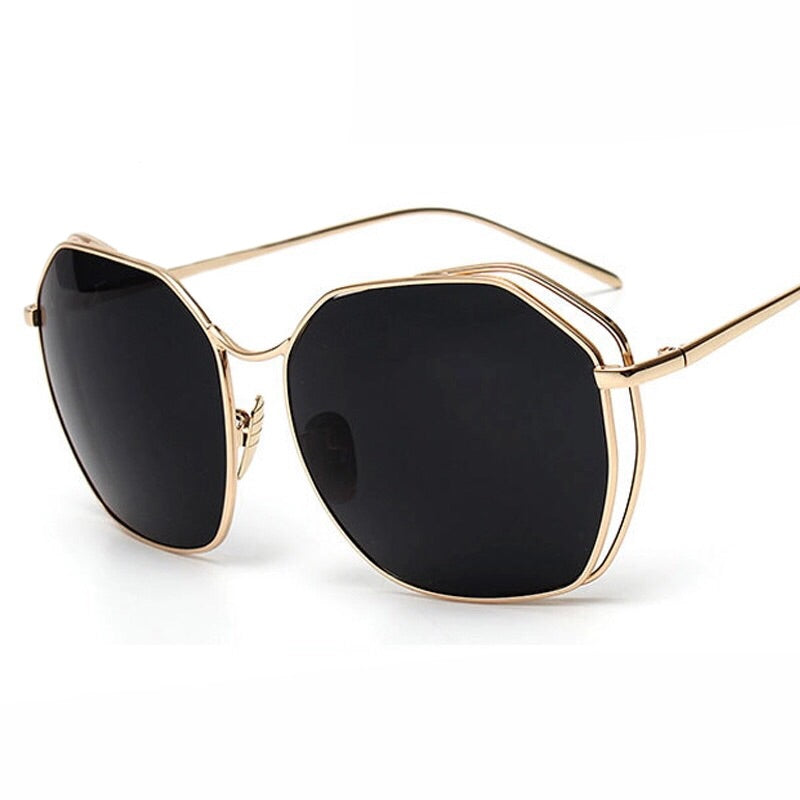 Lucy: Gold Rim Diagonal Shaped Sunglasses