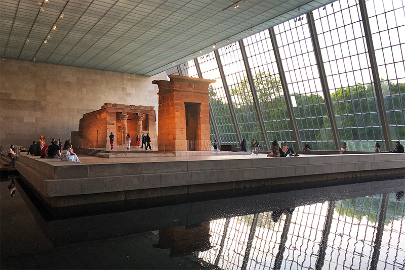 Saturday you find me sketching at the Temple of Dendur. Rain glides quietly down the atrium windows as old friends greet each other with a warm embrace. A glorious lunch at Café Boulud, discussing the Camp exhibition while savoring every bite of the paupiette of sea bass. You find you can't decide between the strawberry charlotte and the chocolate éclair. Outside, bustling crowds hold a prismatic assortment of umbrellas. We see our reflections in steamy shop windows on every block as we run through the rain, hand-in-hand.