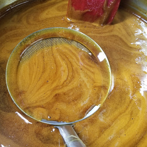 skimming the Rox Orange Sorghum syrup during boil