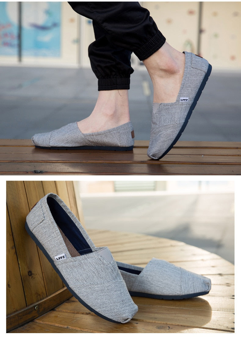 colas slip-ons grey person wearing thumb