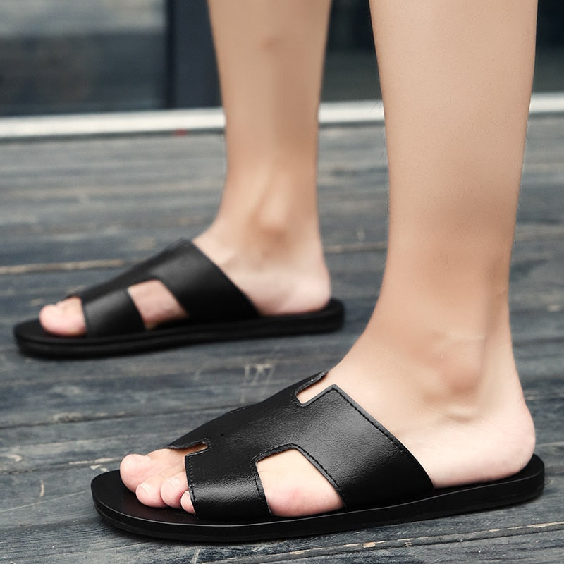 port slides black with person wearing thumb