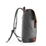 Grey double-buckle canvas and leather backpack side