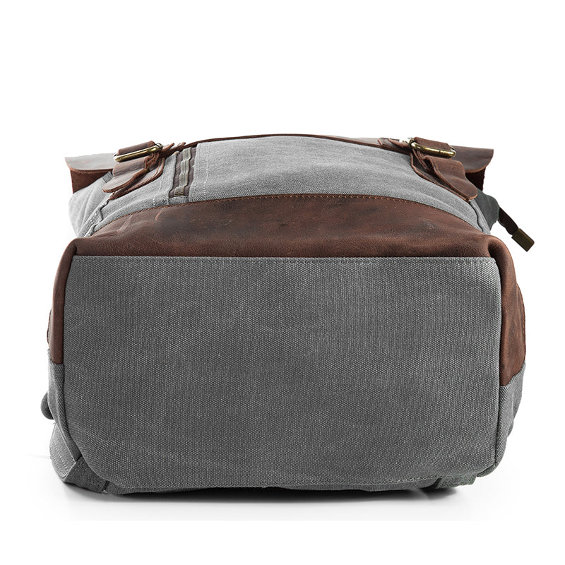 Grey double-buckle canvas and leather backpack bottom