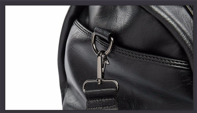 Travel Duffle Black Side With Shoulder Strap Clip Detail