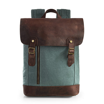 blue double-buckle canvas and leather backpack