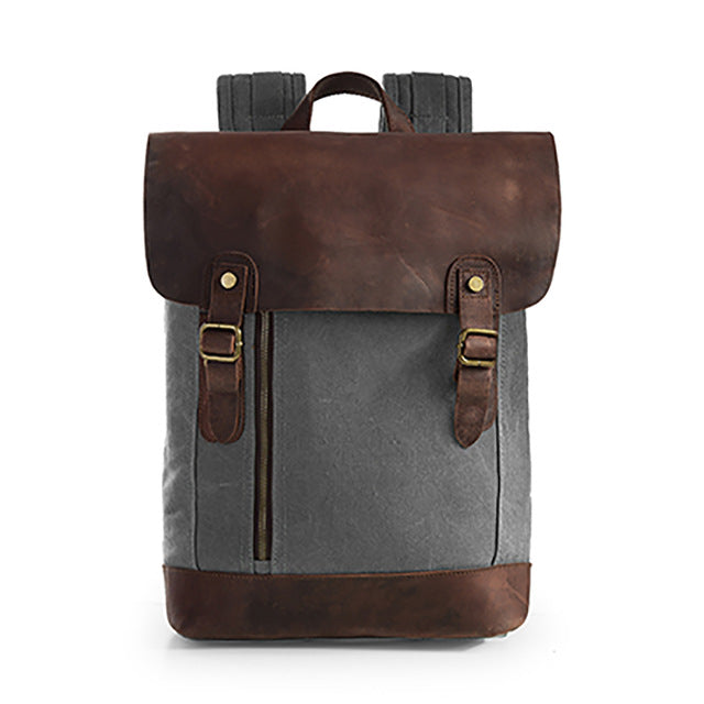 Grey double-buckle canvas and leather backpack