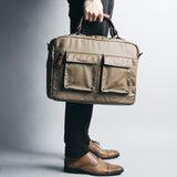 Rubberized Canvas Briefcase Brown With Person Holding