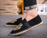 Tiger canvas slip-on espadrille Black/gold on model