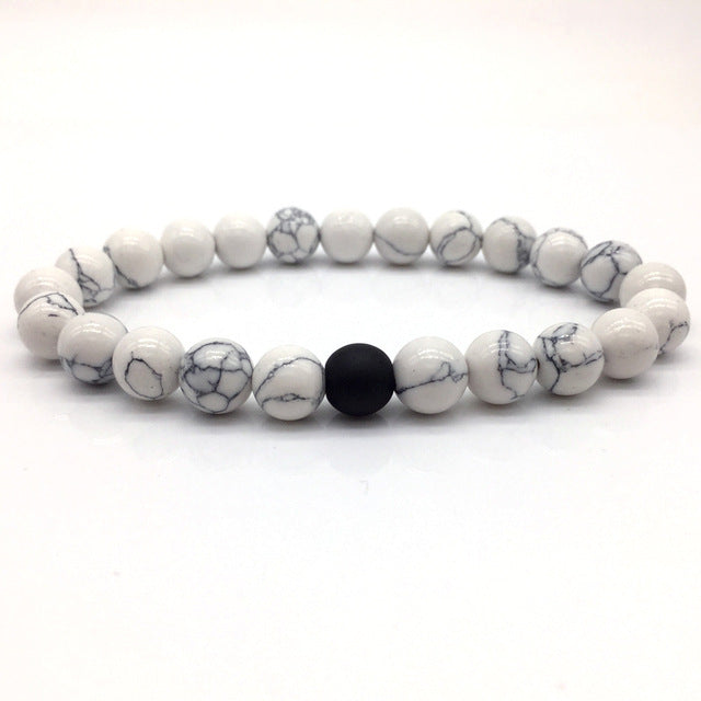 White Stone Bead Bracelet Marbled with Black Bead