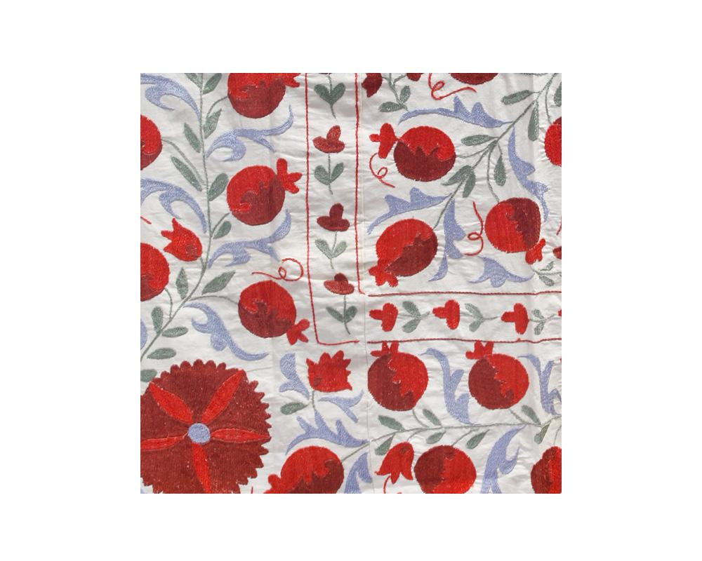 red light blue pomegranate floral suzani embroidered throw detail