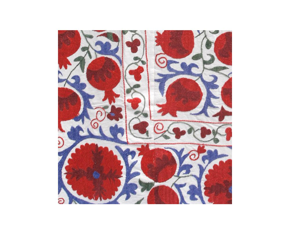 blue and red pomegranate floral embroidered detail suzani throw