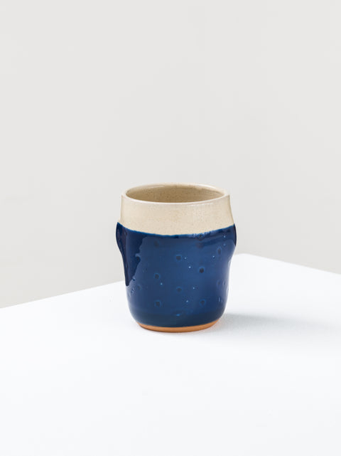 Mug with carved pois