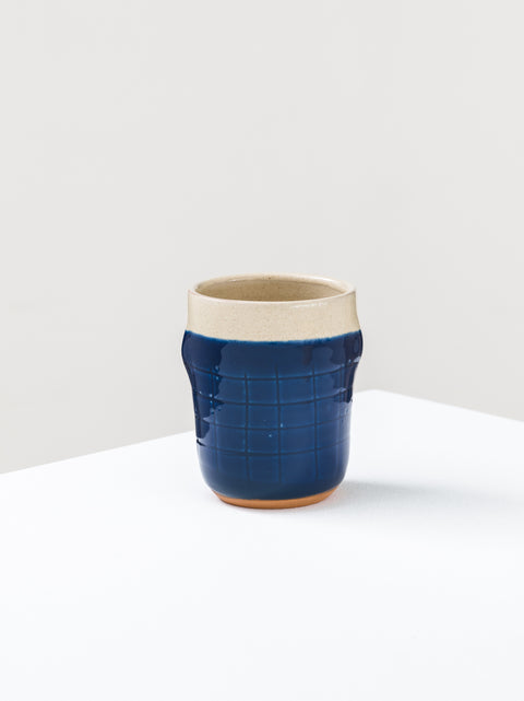 Mug with carved grid