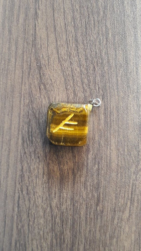 Tigers eye pendant with symbol