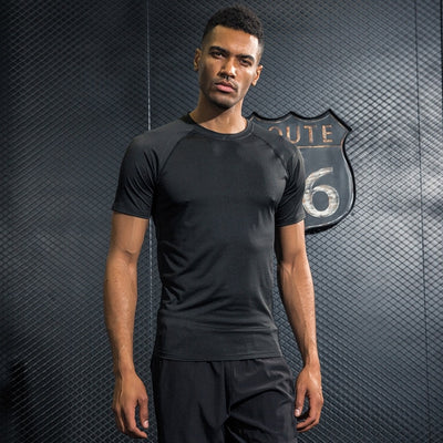 New Men's T-shirts Quick Dry Tight Fitness Running T shirts Men Solid