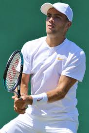 Borna Coric preparing for a return in a full white outfit