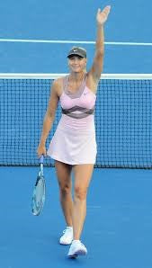 Maria Sharapova in pink dress and waving to the crowd
