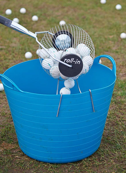 Emptying the Kollectaball Bagbuddy golf shag bag of its balls into a bucket