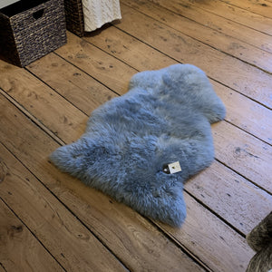 Light grey sheepskin rug