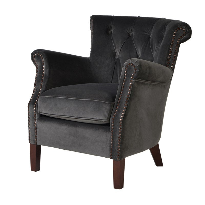 Small dark grey velvet armchair