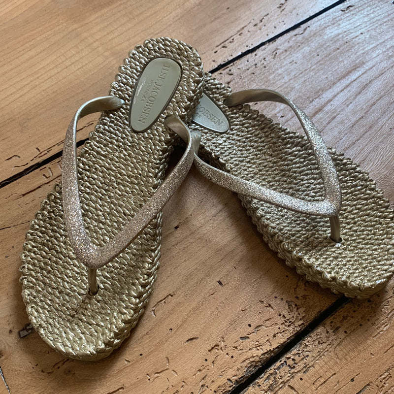 Soft gold rubber flip flop