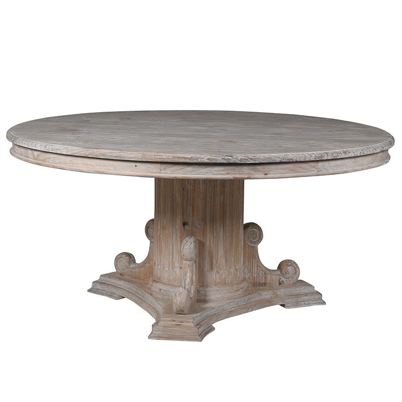 White wash round table with chunky ornate column base