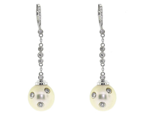 18k White Gold Pearl Earrings With .85ct of Diamonds