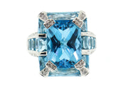 18k Gold Blue Topaz ring with diamonds
