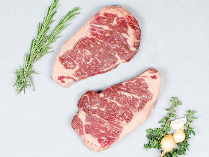 NY STRIP STEAKS, Four 12 oz steaks — 100% Pure Akaushi, a taste of Japan's prized beef, raised in America