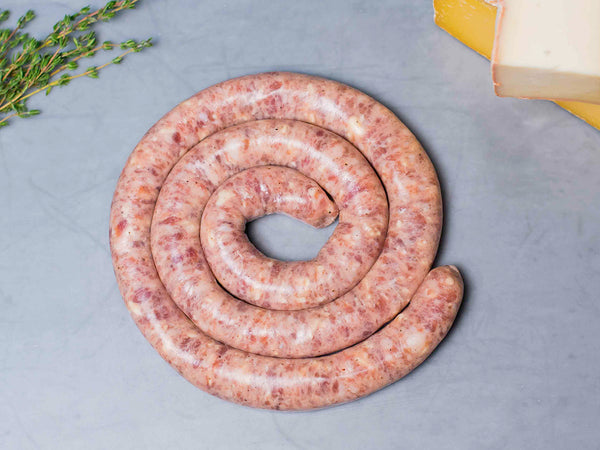 SWEET ITALIAN SAUSAGE WITH CHEESE — Our Cheesemonger Sausage! Little Italy's legendary Pepe Giocoli creates a new classic, made with our 100% heritage pork and cheddar and gruyere shred from Jasper Hill Creamery in Vermont! — Three 1lb wheels