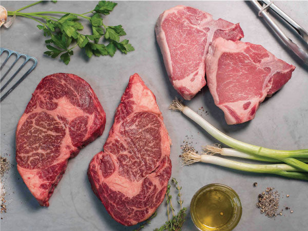 WAGYU NY STRIP STEAKS AND HERITAGE PORK CHOPS, Two 14 oz porterhouse chops and two 14-16 oz NY Strip steaks