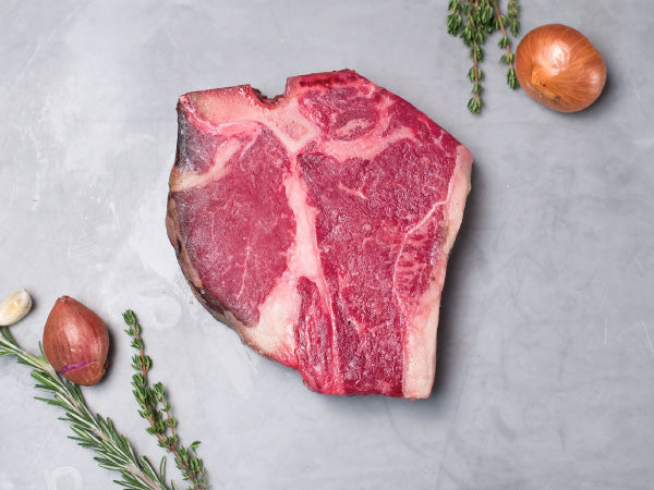 DRY AGED PORTERHOUSE STEAK, OUR SIGNATURE WAGYU, One 30-32oz bone-in steak, 30-day aged — The king of all steaks