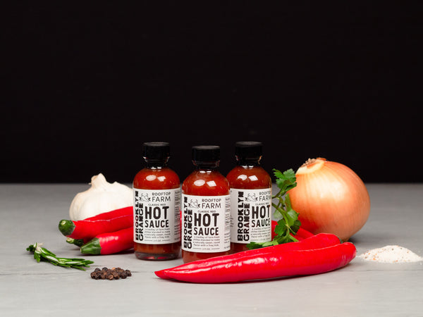 CLASSIC RED HOT SAUCE — farm-fresh chilies delight the senses with sweet undertones in this fiery condiment from Brooklyn Grange, the world's largest rooftop soil farm — Three 2 oz bottles