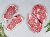 OUR SIGNATURE WAGYU TWO RIBEYE/TWO NY STRIPS, Four 14-16oz steaks