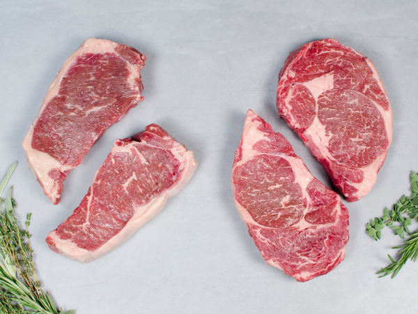 OUR SIGNATURE WAGYU TWO RIBEYE/TWO NY STRIPS, Four 14-16 oz steaks